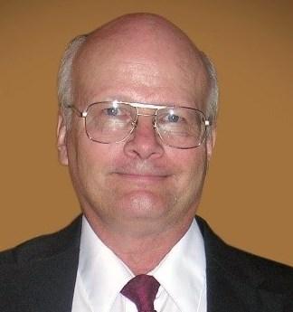 Larry G.  Schmidt