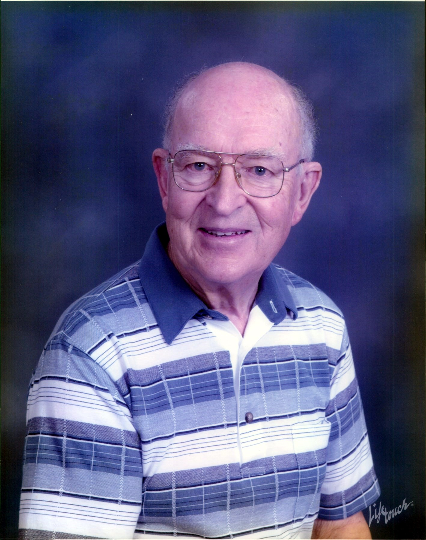 Warren J.  Krause