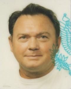 Charles E. (Gene)  Burnett