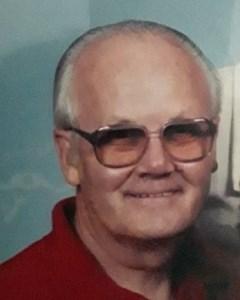 Ralph E.  Cox