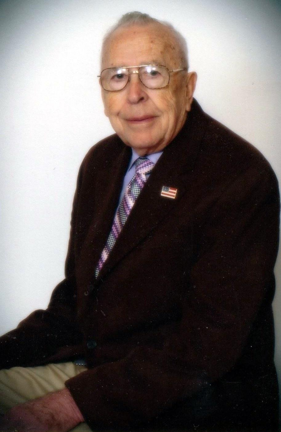 Rev. E. J.  Kearney