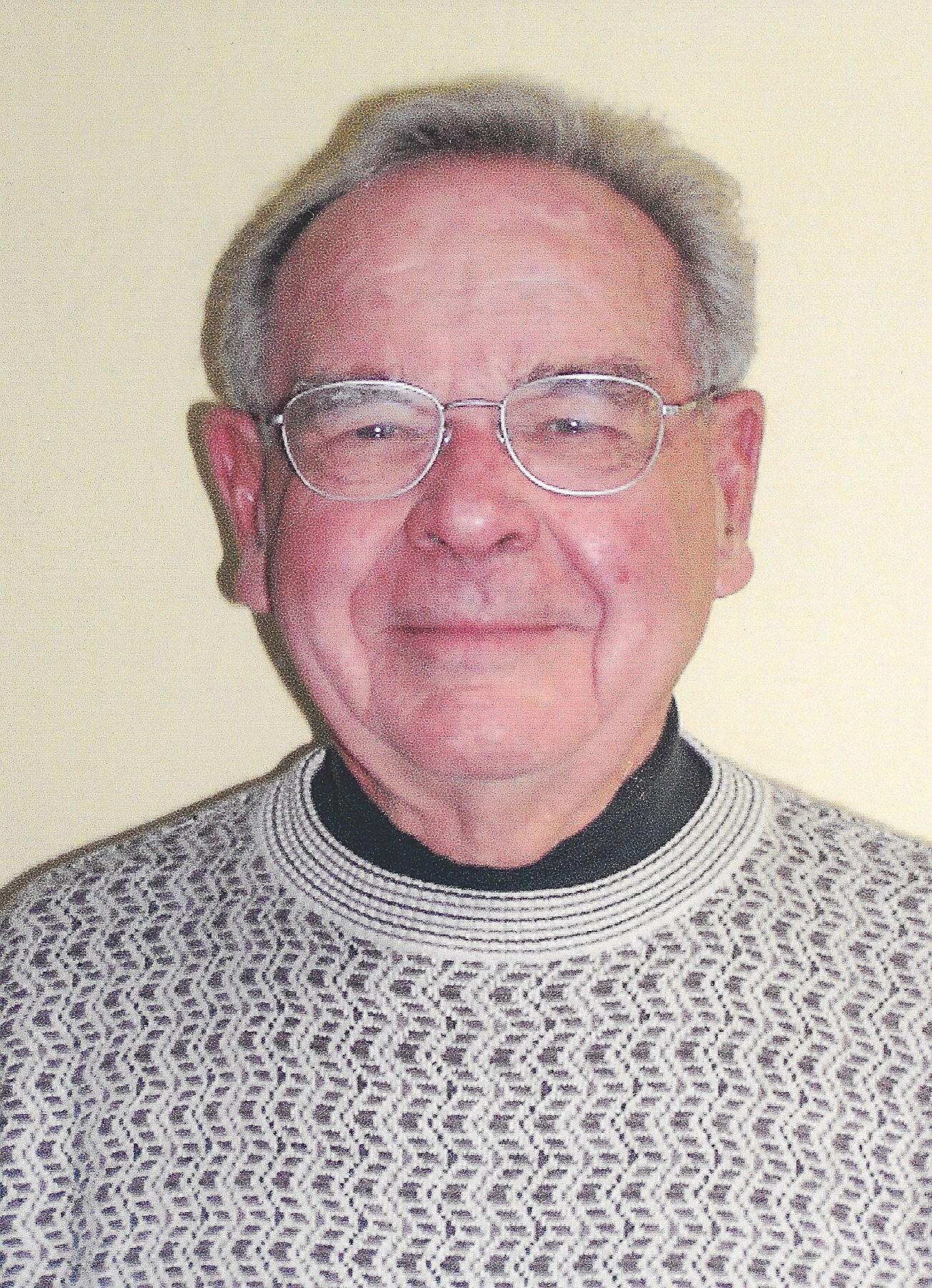 Ernest John  Weller